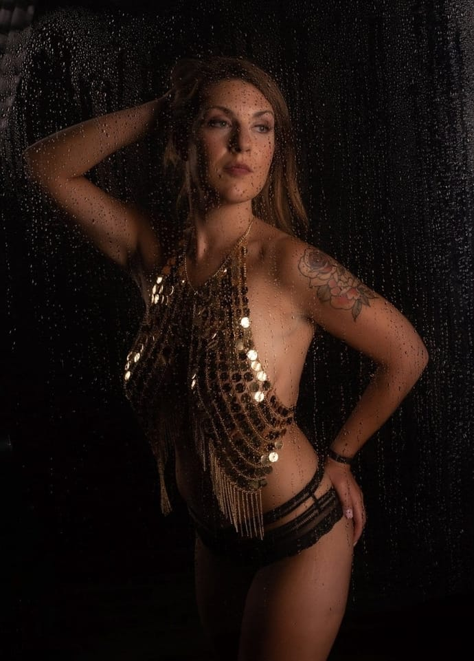 Woman posing in a gold sequin shirt