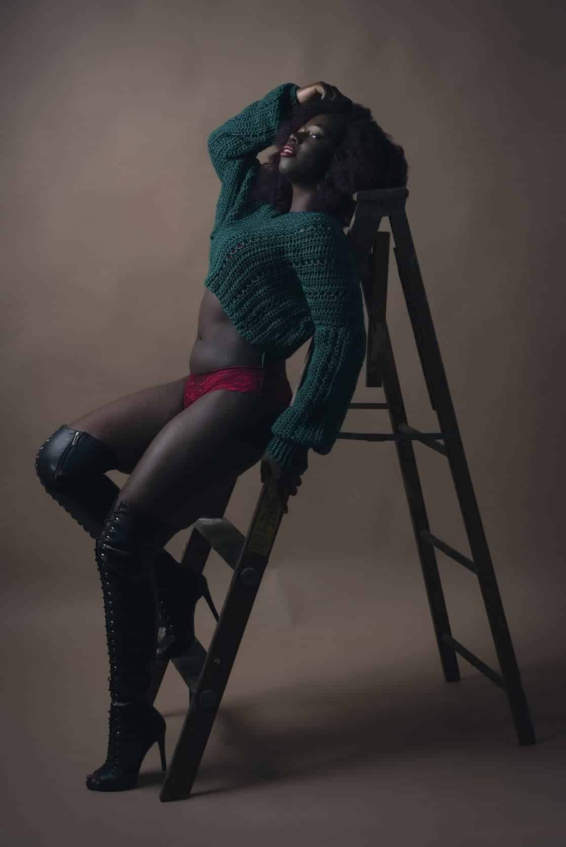African American woman posing in a green sweater